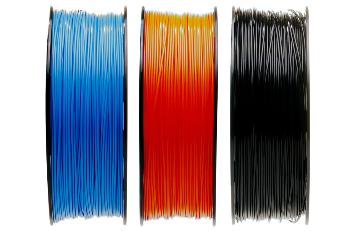 Side view of blue, orange, and black SmartReel filament